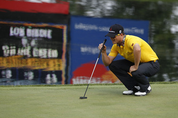 SILVIS, IL - JULY 07:  Zach Johnson lines up a putt during the first round of the John Deere Classic at TPC Deere Run on July 7, 2011 in Silvis, Illinois.  (Photo by Michael Cohen/Getty Images)