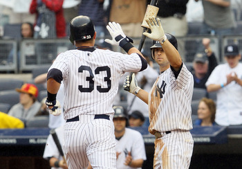 NEW YORK, NY - JUNE 11:  Nick Swisher #33 of the New York Yankees celebrates his seventh inning run against the Cleveland Indians with teammate Brett Gardner #11 on June 11, 2011 at Yankee Stadium in the Bronx borough of New York City.  (Photo by Jim McIs