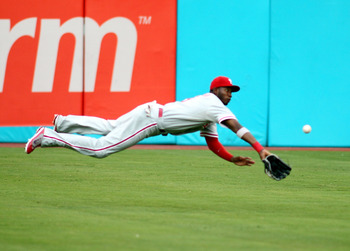 MIAMI GARDENS, FL - JULY 05:  Outfielder Domonic Brown #9 dives for a ball against the Florida Marlins at Sun Life Stadium on July 5, 2011 in Miami Gardens, Florida.  (Photo by Marc Serota/Getty Images)
