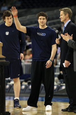 HOUSTON, TX - APRIL 01:  Jimmer Fredette of BYU is named the most outstanding senior student-athlete as it broadcaster Steve Kerr presents him with the award during practice prior to the 2011 Final Four of the NCAA Division I Men's Basketball Tournament a