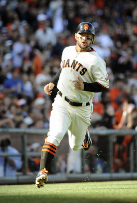 SAN FRANCISCO, CA - JUNE 26: Cody Ross #13 of the San Francisco Giants rounds third base to score on a two RBI double by Chris Stewart #37 against the Cleveland Indians in the bottom of the second inning during a MLB baseball game at AT&T Park June 26, 20