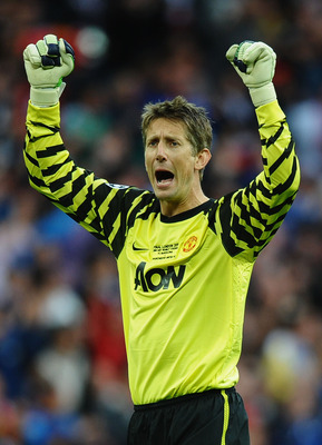 LONDON, ENGLAND - MAY 28:  Edwin van der Sar of Manchester United celebrates as teammate Wayne Rooney (not pictured) scores the equalising goal during the UEFA Champions League final between FC Barcelona and Manchester United FC at Wembley Stadium on May