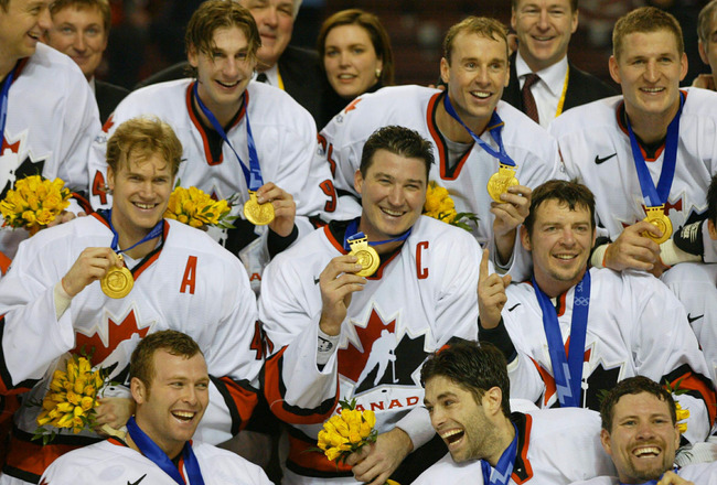401509 01: (NEWSWEEK, US NEWS, MACLEANS, ITALY AND GERMANY OUT) Team Canada led by captain Mario Lemieux (C) pose for a photo with their gold medals after the mens ice hockey gold medal game of the Salt Lake City Winter Olympic Games February 24, 2002 at