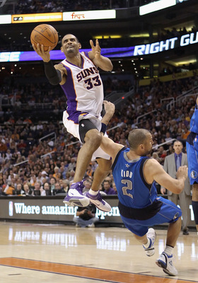 PHOENIX, AZ - MARCH 27:  Grant Hill  #33 of the Phoenix Suns attempts a shot over Jason Kidd #2 of the Dallas Mavericks during the NBA game at US Airways Center on March 27, 2011 in Phoenix, Arizona.  The Mavericks defeated the Suns 91-83.  NOTE TO USER: