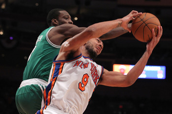 NEW YORK, NY - APRIL 22:  Jared Jeffries #9 of the New York Knicks fights for a rebound against Jeff Green #8 of the Boston Celtics in Game Three of the Eastern Conference Quarterfinals in the 2011 NBA Playoffs on April 22, 2011 at Madison Square Garden i