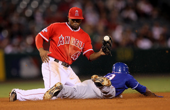 ANAHEIM, CA - SEPTEMBER 21:  Julio Borbon #29 of the Texas Rangers slides into second with a stolen base as second baseman Howie Kendrick #48 of the Los Angeles Angels of Anaheim takes the throw in the eighth inning on September 21, 2010 at Angel Stadium