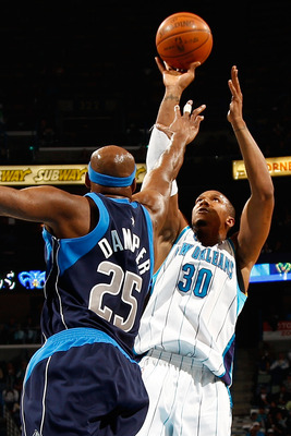 NEW ORLEANS - MARCH 22:  David West #30 of the New Orleans Hornets shoots the ball over Erick Dampier #25 of the Dallas Mavericks at the New Orleans Arena on March 22, 2010 in New Orleans, Louisiana.  NOTE TO USER: User expressly acknowledges and agrees t