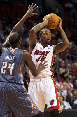 MIAMI - OCTOBER 18:  Forward Udonis Haslam #40 of the Miami Heat looks to pass against Forward Darius Miles #24 of the Charlotte Bobcats on October 18, 2010 at American Airlines Arena in Miami, Florida. NOTE TO USER: User expressly acknowledges and agrees
