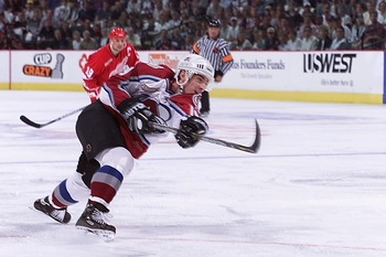5 May 2000:  Joe Sakic #19 of the Colorado Avalanche takes a shot against the Detroit Red Wings in the first period during game five of the Western Conference Semifinals at the Pepsi Center in Denver, Colorado.  The Avalache entered the game leading the s