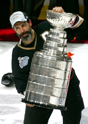 ANAHEIM, CA - JUNE 06:  Captain Scott Niedermayer #27 of the Anaheim Ducks lifts the Stanley Cup after his team's victory over the Ottawa Senators during Game Five of the n June 6, 2007 at Honda Center in Anaheim, California.  The Ducks won the Stanley Cu