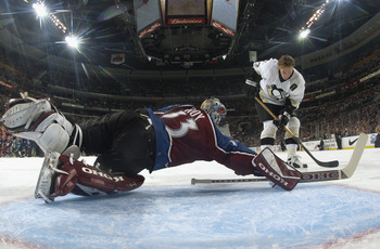 SUNRISE, FL - FEBRUARY 1:  Alexei Kovolev #27 of the Pittsburgh Penguins takes a shot at goaltender Patrick Roy #33 of the Colorado Avalanche during the pass and score event at the NHL All-Star SuperSkills competition at the Office Depot Center on Februar