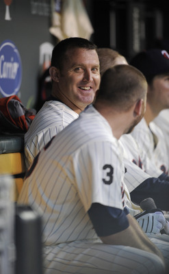 MINNEAPOLIS, MN - MAY 23: Jim Thome #25 and Jason Kubel #16 of the Minnesota Twins in the dugout following a Thome home run against the Seattle Mariners during their game on May 23, 2011 at Target Field in Minneapolis, Minnesota. The Rockies won 6-5. (Pho