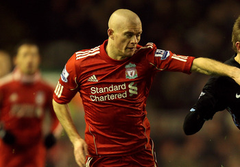 LIVERPOOL, ENGLAND - DECEMBER 06:   Marc Albrighton of Aston Villa is challenged by Paul Konchesky of Liverpool during the Barclays Premier League match between Liverpool and Aston Villa at Anfield on December 6, 2010 in Liverpool, England. (Photo by Mark