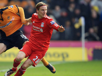 WOLVERHAMPTON, ENGLAND - JANUARY 22:  Steven Fletcher of Wolverhampton Wanderers tangles with Christian Poulsen of Liverpool during the Barclays Premier League match between Wolverhampton Wanderers and Liverpool at Molineux on January 22, 2011 in Wolverha