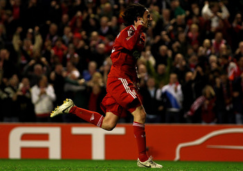 LIVERPOOL, ENGLAND - APRIL 29:  Alberto Aquilani of Liverpool celebrates scoring the opening goal during the UEFA Europa League Semi-Final Second Leg match between Liverpool and Atletico Madrid at Anfield on April 29, 2010 in Liverpool, England.  (Photo b