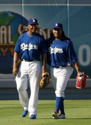 LOS ANGELES, CA - AUGUST 01:  Manny Ramirez #99 of the Los Angeles Dodgers talks with new teammate Andruw Jones #25 during batting practice before the game against  the Arizona Diamondbacks on August 1, 2008 at Dodger Stadium in Los Angeles, California.