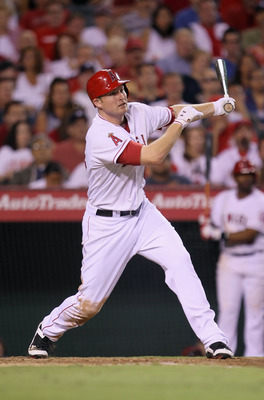 ANAHEIM, CA - JULY 04:  Mark Trumbo #44 of the Los Angeles Angels of Anaheim hits a base hit against the Detroit Tigers in the eighth inning at Angel Stadium of Anaheim on July 4, 2011 in Anaheim, California. The Angels defeated the Tigers 5-1.  (Photo by