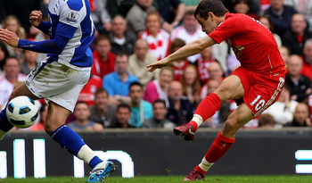 LIVERPOOL, ENGLAND - APRIL 23:  Joe Cole of Liverpool scores his team's fifth goal during the Barclays Premier League match between Liverpool and Birmingham City at Anfield on April 23, 2011 in Liverpool, England.  (Photo by Clive Brunskill/Getty Images)
