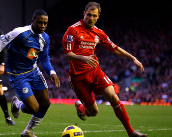 LIVERPOOL, ENGLAND - FEBRUARY 12:  Charles N' Zogbia of Wigan Athletic competes with Milan Jovanovic of Liverpool during the Barclays Premier League match between Liverpool and Wigan Athletic at Anfield on February 12, 2011 in Liverpool, England. (Photo b