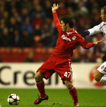 LIVERPOOL, UNITED KINGDOM - DECEMBER 09:   Daniel Pacheco of Liverpool is pulled back by Cesare Natali of Fiorentina during the UEFA Champions League Group E match between Liverpool and Fiorentina at Anfield on December 9, 2009 in Liverpool, England. (Pho