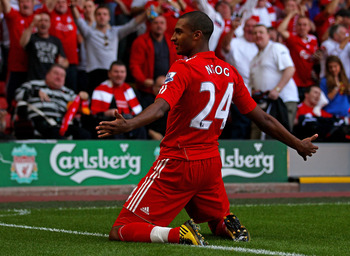 LIVERPOOL, ENGLAND - AUGUST 15:  David Ngog of Liverpool celebrates scoring the opening goal during the Barclays Premier League match between Liverpool and Arsenal at Anfield on August 15, 2010 in Liverpool, England.  (Photo by Clive Brunskill/Getty Image