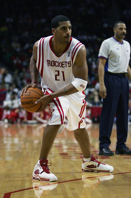 HOUSTON - DECEMBER 11:  Jim Jackson #21 of the Houston Rockets looks to pass against the Dallas Mavericks on December 11, 2004 at the Toyota Center in Houston, Texas.  The Mavericks won 102-78.  NOTE TO USER: User expressly acknowledges and agrees that, b