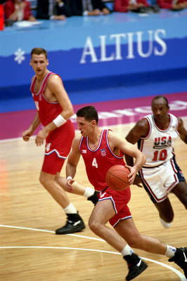 BARCELONA, SPAIN - AUGUST 8:  Drazen Petrovic #4 of Croatia moves the ball past Clyde Drexler #10 of the United States in the 1992 Olympic game on August 8, 1992 in Barcelona, Spain. The 'Dream Team' defeated Croatia 117-85. NOTE TO USER: User expressly a