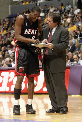 LOS ANGELES - NOVEMBER 16:  Head coach Stan Van Gundy of the Miami Heat goes over his notes with Eddie Jones #6 in their game with the Los Angeles Lakers on November 16, 2003 at Staples Center in Los Angeles, California. NOTE TO USER: User expressly ackno
