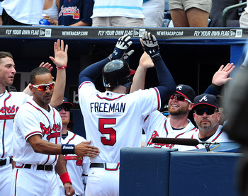 ATLANTA - JULY 7: Freddie Freeman #5 of the Atlanta Braves is congratulated by teammates after hitting a 3rd inning home run against the Colorado Rockies at Turner Field on July 7, 2011 in Atlanta, Georgia. (Photo by Scott Cunningham/Getty Images)