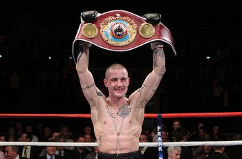 GLASGOW, SCOTLAND - MARCH 12:  Ricky Burns defeats Joseph Laryea to retain the WBO Super Featherweight Championship of The World contest at the Braehead Arena on December 12, 2011 in Glasgow, Scotland. (Photo by Ian MacNicol/Getty Images)