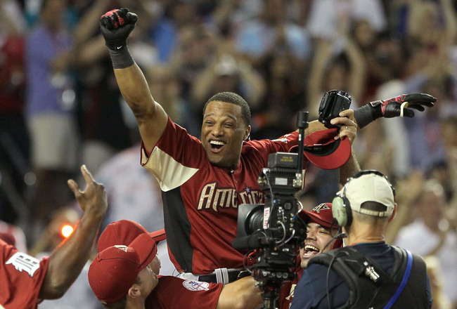 PHOENIX, AZ - JULY 11:  American League All-Star Robinson Cano #24 of the New York Yankees reacts after winning the 2011 State Farm Home Run Derby at Chase Field on July 11, 2011 in Phoenix, Arizona. Cano won the 2011 State Farm Home Run Derby with a reco