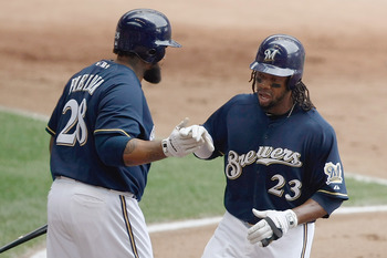 MILWAUKEE, WI - JULY 10: Rickie Weeks #23 of the Milwaukee Brewers is congratulated by Prince Fielder #28 after scoring a run against the Cincinnati Reds at Miller Park on July 10, 2011 in Milwaukee, Wisconsin. (Photo by Scott Boehm/Getty Images)