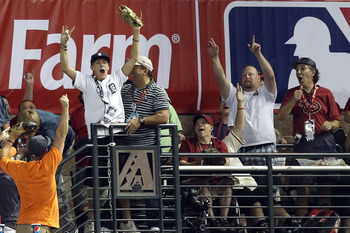 PHOENIX, AZ - JULY 11:  Fans react to a home run during the 2011 State Farm Home Run Derby at Chase Field on July 11, 2011 in Phoenix, Arizona.  (Photo by Christian Petersen/Getty Images)