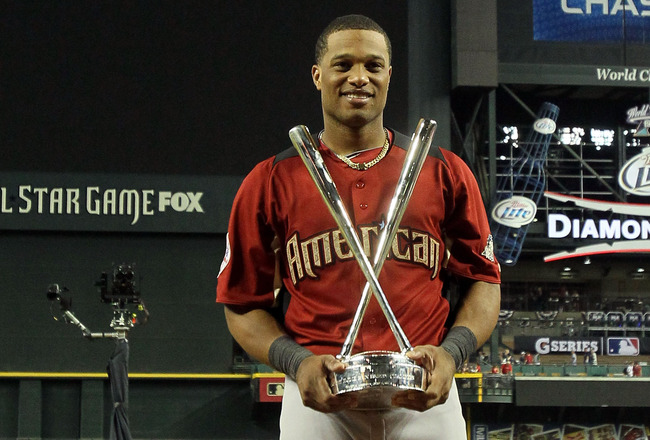 PHOENIX, AZ - JULY 11:  American League All-Star Robinson Cano #24 of the New York Yankees celebrates with the trophy after winning the 2011 State Farm Home Run Derby at Chase Field on July 11, 2011 in Phoenix, Arizona. Cano won the 2011 State Farm Home R