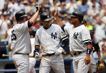 NEW YORK - JULY 30:  Derek Jeter #2 and Bobby Abreu #53 of the New York Yankees celebrate with teammate Jason Giambi #25 after scoring against the Baltimore Orioles in the first inning on July 30, 2008 at Yankee Stadium in the Bronx borough of New York Ci