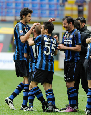 MILAN, ITALY - APRIL 23:  Wesley Sneijder (2nd L) of Inter Milan is congratulated by team-mates after scoring the 1-1 equaliser during the Serie A match between FC Internazionale Milano and SS Lazio at Stadio Giuseppe Meazza on April 23, 2011 in Milan, It