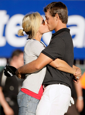 MELBOURNE, AUSTRALIA - NOVEMBER 25:  Aaron Baddeley of Australia kisses his wife Richelle after claiming victory in the MasterCard Masters at Huntingdale Golf Course on November 25, 2007 in Melbourne, Australia.  (Photo by Robert Cianflone/Getty Images)