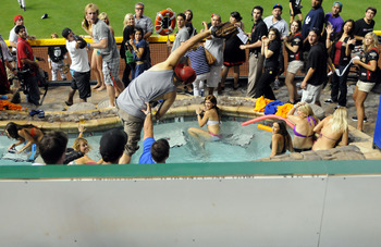 PHOENIX, AZ - JULY 11:  A fan catches a home run ball in the pool during the 2011 State Farm Home Run Derby at Chase Field on July 11, 2011 in Phoenix, Arizona.  (Photo by Norm Hall/Getty Images)