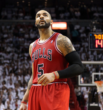 MIAMI, FL - MAY 24:  Carlos Boozer #5 of the Chicago Bulls looks on against the Miami Heat in Game Four of the Eastern Conference Finals during the 2011 NBA Playoffs on May 24, 2011 at American Airlines Arena in Miami, Florida. The Heat won 101-93 in over