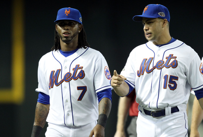 PHOENIX, AZ - JULY 12:   National League All-Star Jose Reyes #7 of the New York Mets and National League All-Star Carlos Beltran #15 of the New York Mets talk during batting practice before the start of the 82nd MLB All-Star Game at Chase Field on July 12