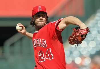 ANAHEIM, CA - JUNE 29:  Dan Haren #24 of the Los Angeles Angels of Anaheim pitches against the Washington Nationals at Angel Stadium of Anaheim on June 29, 2011 in Anaheim, California.  (Photo by Jeff Gross/Getty Images)