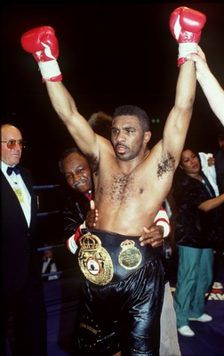 26 FEB 1994:  STEVE LITTLE (USA) RAISES HIS FISTS IN TRIUMPH, WITH THE  WBA SUPER-MIDDLEWEIGHT BELT AROUND HIS WAIST, AFTER DEFEATING CHAMPION MICHAEL NUNN (USA) AT EARLS COURT, LONDON. LITTLE  WON THE FIGHT ON A SPLIT DECISION, AND THE 115-112, 116-114,1
