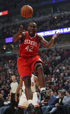 CHICAGO, IL - DECEMBER 21: Elton Brand #42 of the Philadelphia 76ers looses control of the ball after a block by Kurt Thomas of the Chicago Bulls at the United Center on December 21, 2010 in Chicago, Illinois. NOTE TO USER: User expressly acknowledges and