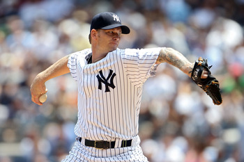 NEW YORK, NY - JULY 09:  A.J. Burnett #34 of the New York Yankees pitches against the Tampa Bay Rays at Yankee Stadium on July 9, 2011 in the Bronx borough of New York City.  (Photo by Michael Heiman/Getty Images)