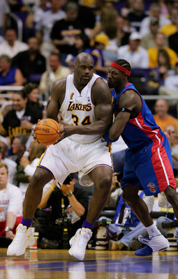 LOS ANGELES - JUNE 6:  Shaquille O'Neal #34 of the Los Angeles Lakers is defended by Ben Wallace #3 of the Detroit Pistons in Game one of the 2004 NBA Finals at Staples Center on June 6, 2004 in Los Angeles, California. The Pistons won 87-75.  NOTE TO USE