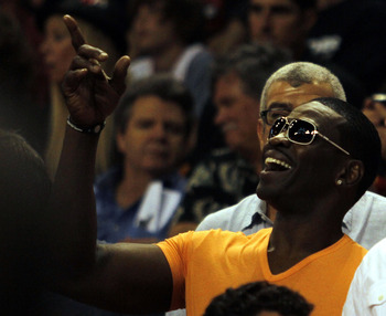 MIAMI - OCTOBER 29: Former NFL Hall of Fame receiver Michael Irvin points prior to the Miami Heat's game against the Orlando Magic at American Airlines Arena on October 29, 2010 in Miami, Florida.  NOTE TO USER: User expressly acknowledges and agrees that