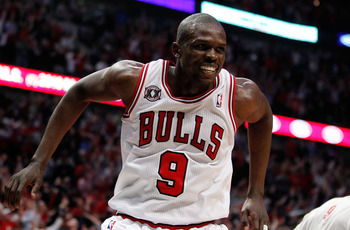 CHICAGO, IL - MAY 18: Luol Deng #9 of the Chicago Bulls reacts after he made a 50-foot 3-poit shot at the buzzer of the end of the first quarter against the Miami Heat in Game Two of the Eastern Conference Finals during the 2011 NBA Playoffs on May 18, 20