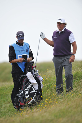 SANDWICH, ENGLAND - JULY 12:  Phil Mickelson of the USA pulls a club during the second practice round during The Open Championship at Royal St. George's on July 12, 2011 in Sandwich, England. The 140th Open begins on July 14, 2011.  (Photo by Stuart Frank