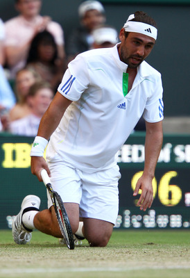 LONDON, ENGLAND - JUNE 25:  Marcos Baghdatis of Cyprus reacts during his third round match against Novak Djokovic of Serbia on Day Six of the Wimbledon Lawn Tennis Championships at the All England Lawn Tennis and Croquet Club on June 25, 2011 in London, E