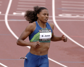 Marion Jones wins a qualifying heat in the women's 100-meter dash in 11.17 seconds June 23 at the 2006 AT&T Outdoor Track and Field Championships in Indianapolis, Indiana at Michael A. Carroll Stadium. (Photo by A. Messerschmidt/Getty Images)